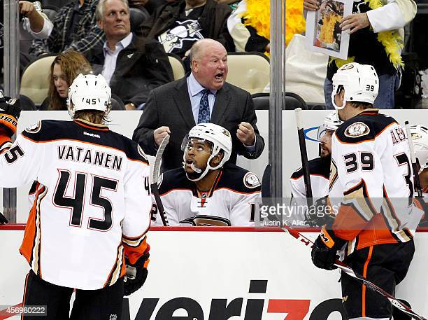 Head coach Bruce Boudreau of the Anaheim Ducks exhorts his team during a timeout during the season opener against the Pittsburgh Penguins at Consol...