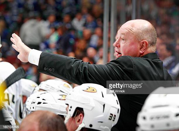 Head coach Bruce Boudreau of the Anaheim Ducks looks on from the bench during their seasonopening NHL game against the Vancouver Canucks at Rogers...