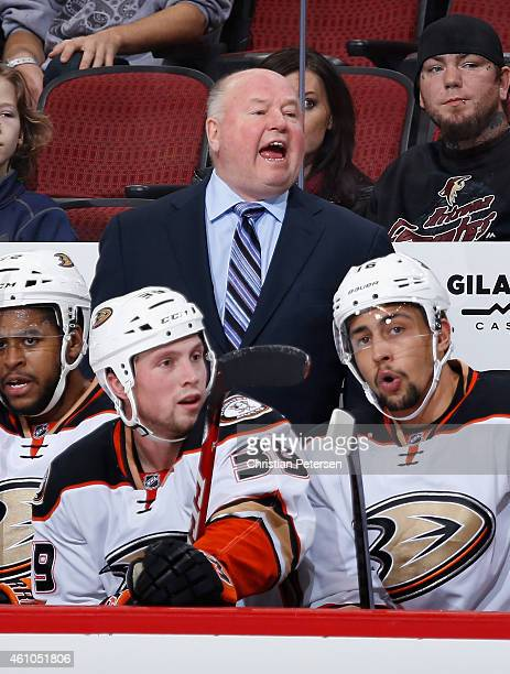 Head coach Bruce Boudreau of the Anaheim Ducks on the bench during the NHL game against the Arizona Coyotes at Gila River Arena on December 27 2014...