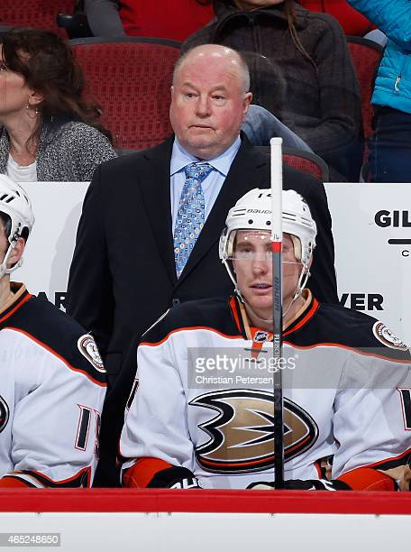 Head coach Bruce Boudreau of the Anaheim Ducks on the bench during the NHL game against the Arizona Coyotes at Gila River Arena on March 3 2015 in...