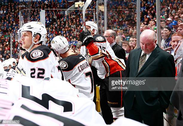 Head coach Bruce Boudreau of the Anaheim Ducks stands dejected on the bench after losing to the the Vancouver Canucks during their NHL game at Rogers...