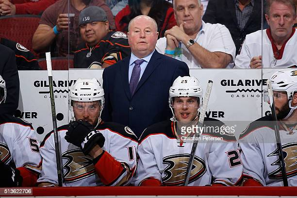 Head coach Bruce Boudreau of the Anaheim Ducks watches from the bench during the NHL game against the Arizona Coyotes at Gila River Arena on March 3...