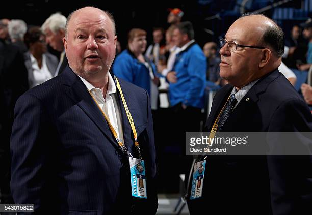 Head Coach Bruce Boudreau of the Minnesota Wild and Scotty Bowman of the Chicago Blackhawks look on during the 2016 NHL Draft at First Niagara Center...