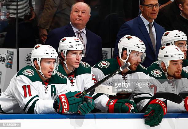 Head coach Bruce Boudreau of the Minnesota Wild looks on from the bench as his team plays the Toronto Maple Leafs during the second period at the Air...
