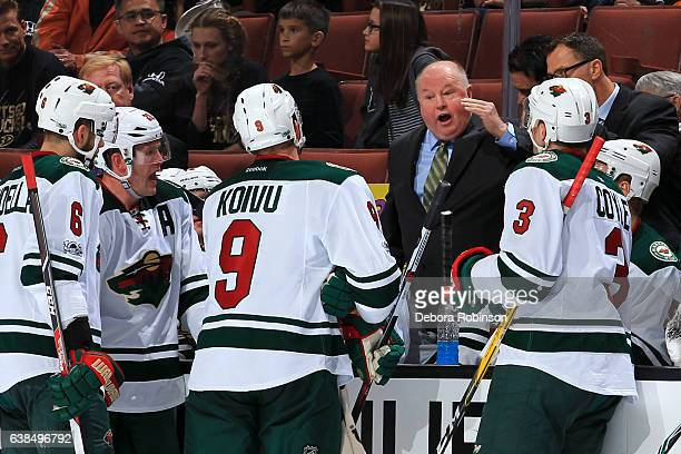Head coach Bruce Boudreau of the Minnesota Wild talks to his players during a time out in the game against the Anaheim Ducks on January 8 2017 at...
