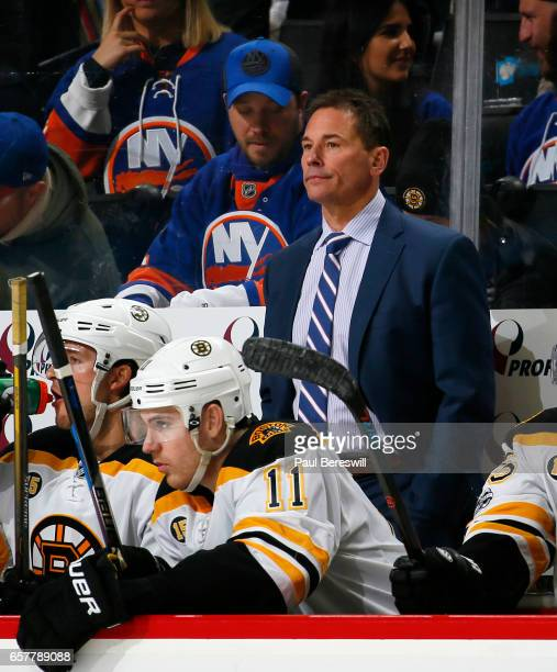 Head coach Bruce Cassidy of the Boston Bruins looks on during the second period against the New York Islanders at the Barclays Center on March 25...