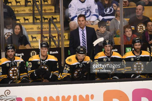 Head Coach Bruce Cassidy of the Boston Bruins watches the third period against the Tampa Bay Lightning at the TD Garden on April 4 2017 in Boston...