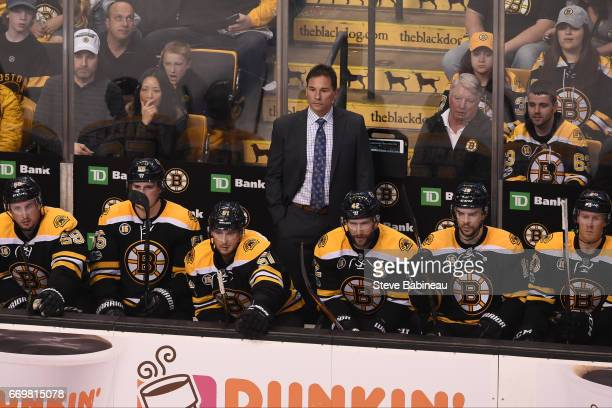 Head Coach Bruce Cassidy of the Boston Bruins watches the third period against the Ottawa Senators in Game Three of the Eastern Conference First...