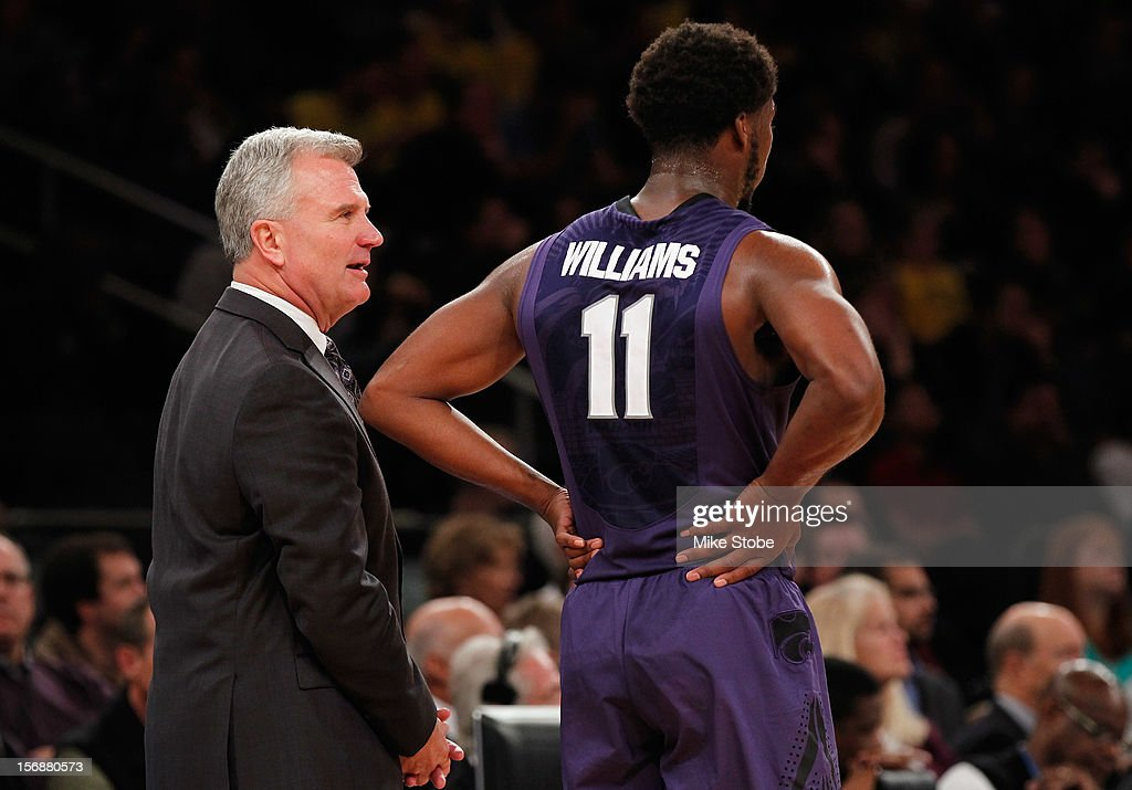 Head Coach Bruce Weber of Kansas State Wildcats speaks with Nino Williams #11 during the game against the Michigan Wolverines at Madison Square Garden on November 23, 2012 in New York City. Michigan Wolverines defeated Kansas State Wildcats 71-57.