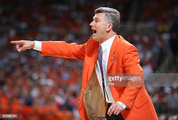 Head coach Bruce Weber of the Illinois Fighting Illini yells out instructions to his team against the North Carolina Tar Heels in the second half of...