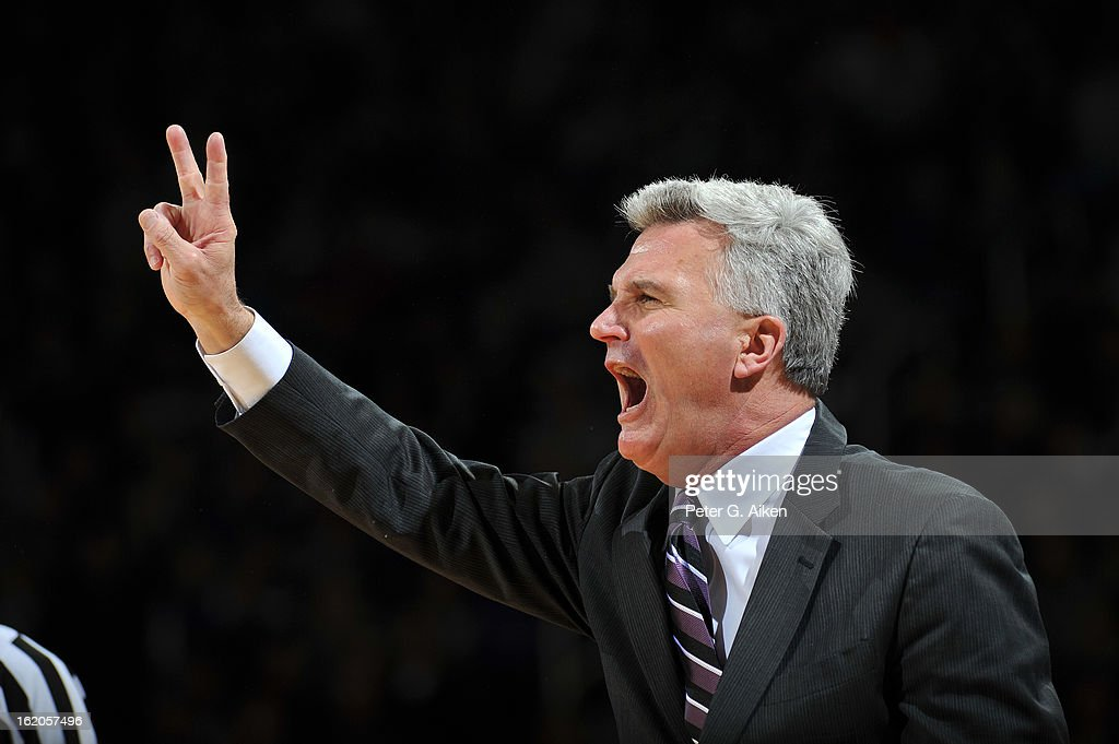 Head coach Bruce Weber (R) of the Kansas State Wildcats calls out a play against the West Virginia Mountaineers in the second half on February 18, 2013 at Bramlage Coliseum in Manhattan, Kansas. Kansas State defeated West Virginia 71-61.