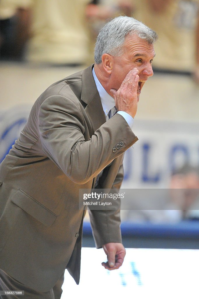 Head coach <a gi-track='captionPersonalityLinkClicked' href=/galleries/search?phrase=Bruce+Weber+-+Basketball+Coach&family=editorial&specificpeople=15087708 ng-click='$event.stopPropagation()'>Bruce Weber</a> of the Kansas State Wildcats calls to his players during a college basketball game against the George Washington Colonials on December 8, 2012 at the Smith Center in Washington, DC. The Wildcats won 65-62.