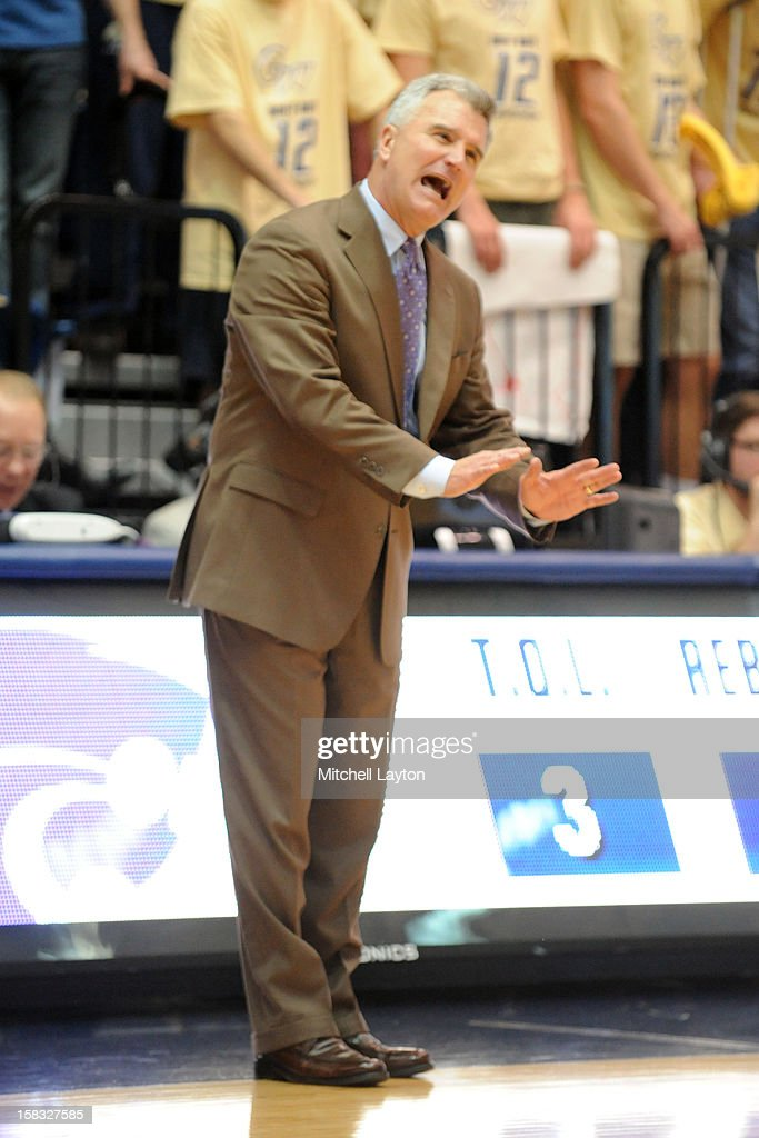 Head coach <a gi-track='captionPersonalityLinkClicked' href=/galleries/search?phrase=Bruce+Weber+-+Basketball+Coach&family=editorial&specificpeople=15087708 ng-click='$event.stopPropagation()'>Bruce Weber</a> of the Kansas State Wildcats calms his player sdown during a college basketball game against the George Washington Colonials on December 8, 2012 at the Smith Center in Washington, DC. The Wildcats won 65-62.