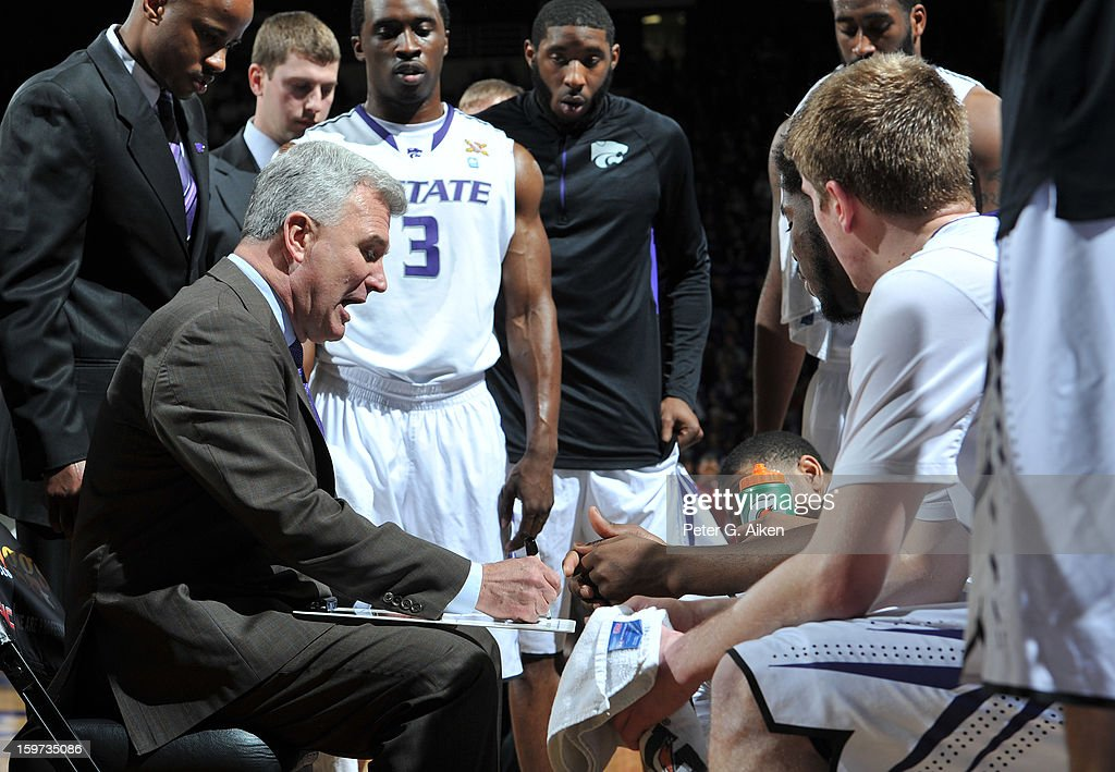 Head coach Bruce Weber of the Kansas State Wildcats draws out a play during a time-out against the Oklahoma Sooners during the second half on January 19, 2013 at Bramlage Coliseum in Manhattan, Kansas. Kansas State defeated Oklahoma 69-60.