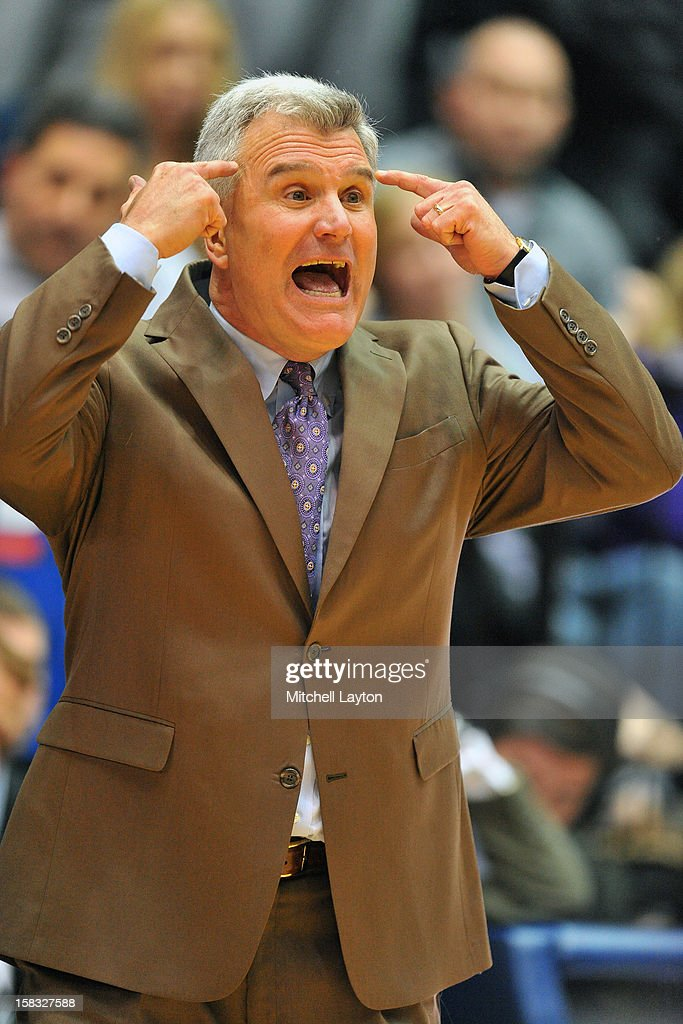 Head coach <a gi-track='captionPersonalityLinkClicked' href=/galleries/search?phrase=Bruce+Weber+-+Basketball+Coach&family=editorial&specificpeople=15087708 ng-click='$event.stopPropagation()'>Bruce Weber</a> of the Kansas State Wildcats reacts a play during a college basketball game against the George Washington Colonials on December 8, 2012 at the Smith Center in Washington, DC. The Wildcats won 65-62.