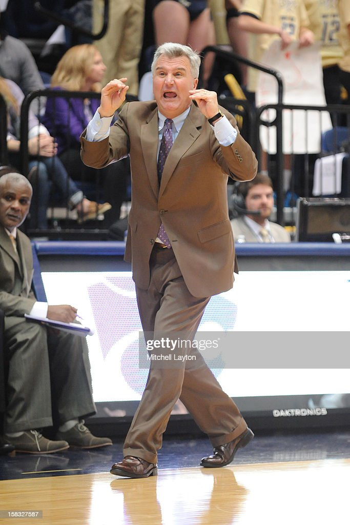 Head coach <a gi-track='captionPersonalityLinkClicked' href=/galleries/search?phrase=Bruce+Weber+-+Basketball+Coach&family=editorial&specificpeople=15087708 ng-click='$event.stopPropagation()'>Bruce Weber</a> of the Kansas State Wildcats reacts to a call during a college basketball game against the George Washington Colonials on December 8, 2012 at the Smith Center in Washington, DC. The Wildcats won 65-62.