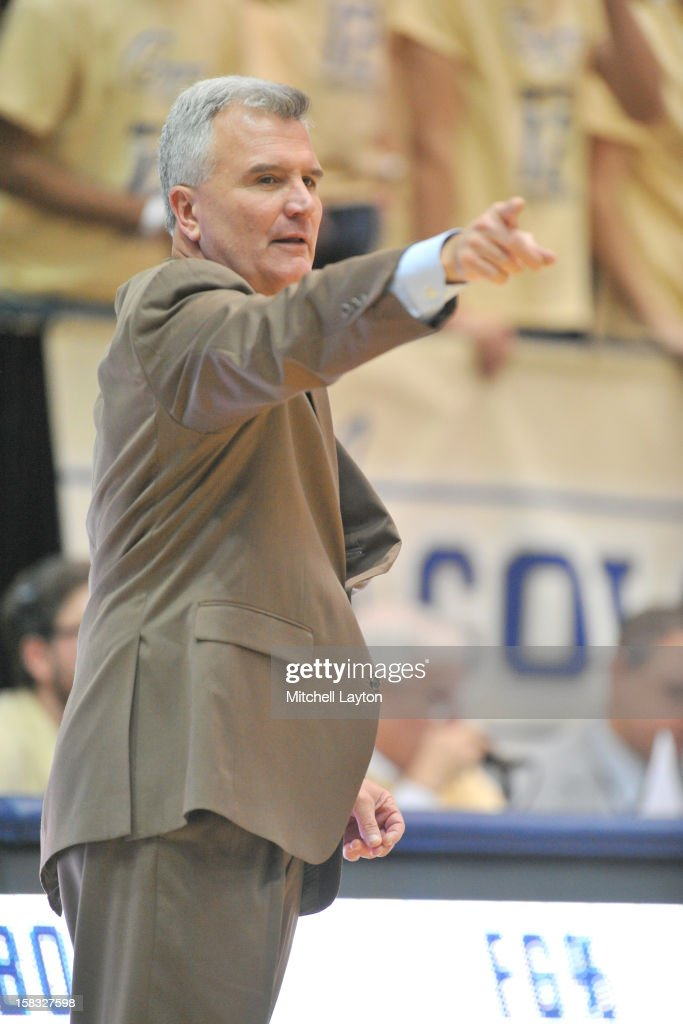 Head coach <a gi-track='captionPersonalityLinkClicked' href=/galleries/search?phrase=Bruce+Weber+-+Basketball+Coach&family=editorial&specificpeople=15087708 ng-click='$event.stopPropagation()'>Bruce Weber</a> of the Kansas State Wildcats signals during a college basketball game against the George Washington Colonials on December 8, 2012 at the Smith Center in Washington, DC. The Wildcats won 65-62.