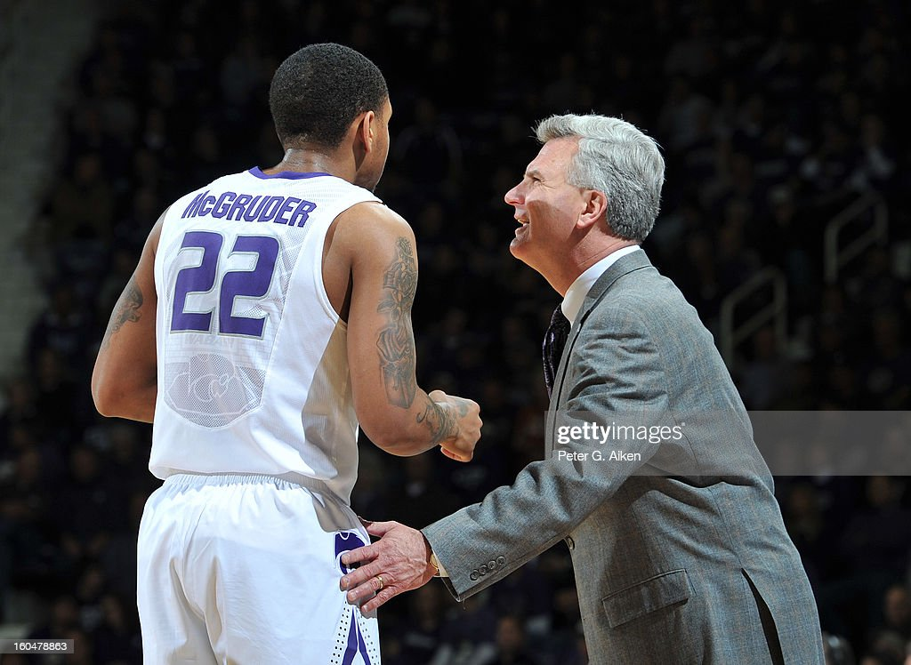 Head coach Bruce Weber (R) of the Kansas State Wildcats talks with guard Rodney McGruder #22 of the Texas Longhorns during the second half on January 30, 2013 at Bramlage Coliseum in Manhattan, Kansas.