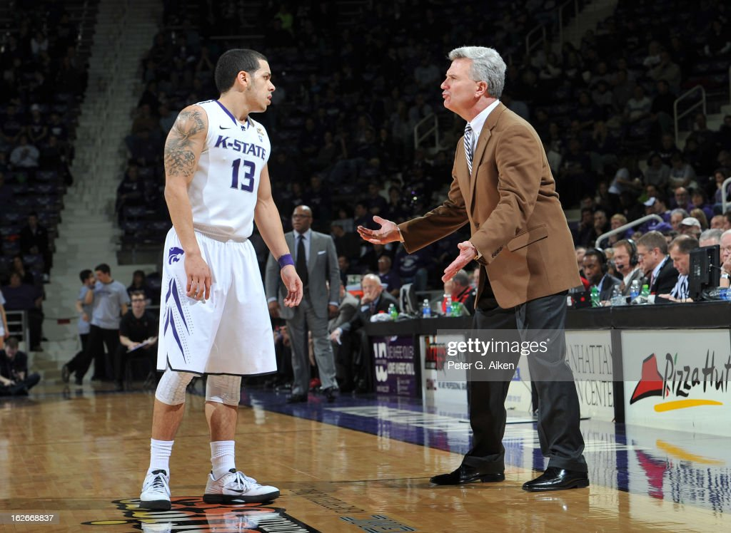 Head coach <a gi-track='captionPersonalityLinkClicked' href=/galleries/search?phrase=Bruce+Weber+-+Basketball+Coach&family=editorial&specificpeople=15087708 ng-click='$event.stopPropagation()'>Bruce Weber</a> of the Kansas State Wildcats talks with guard Angel Rodriguez #13 against the Texas Tech Red Raiders during the second half on February 25, 2013 at Bramlage Coliseum in Manhattan, Kansas. Kansas State defeated Texas Tech 75-55.