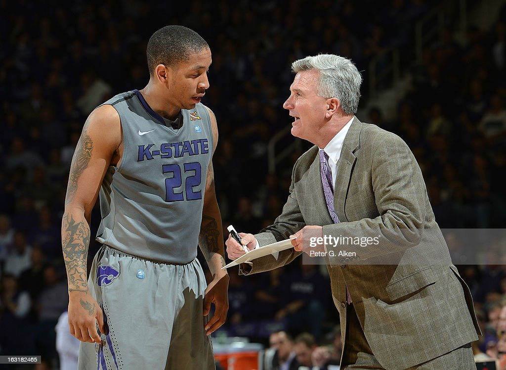 Head coach Bruce Weber of the Kansas State Wildcats talks with guard Rodney McGruder #22 during the second half against the Texas Christian Horned Frogs on March 5, 2013 at Bramlage Coliseum in Manhattan, Kansas. Kansas State defeated Texas Christian 79-68.