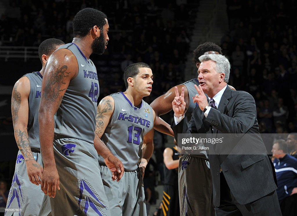 Head coach Bruce Weber (R) of the Kansas State Wildcats talks with his players during a brake in the action against the West Virginia Mountaineers in the second half on February 18, 2013 at Bramlage Coliseum in Manhattan, Kansas. Kansas State defeated West Virginia 71-61.