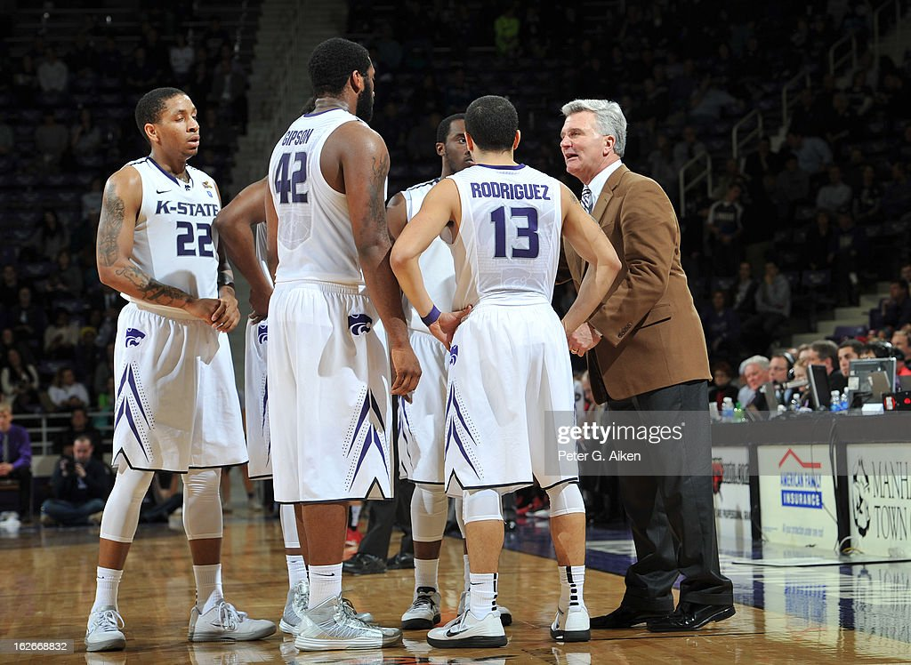 Head coach <a gi-track='captionPersonalityLinkClicked' href=/galleries/search?phrase=Bruce+Weber+-+Basketball+Coach&family=editorial&specificpeople=15087708 ng-click='$event.stopPropagation()'>Bruce Weber</a> of the Kansas State Wildcats (far right) talks with his players against the Texas Tech Red Raiders during the second half on February 25, 2013 at Bramlage Coliseum in Manhattan, Kansas. Kansas State defeated Texas Tech 75-55.