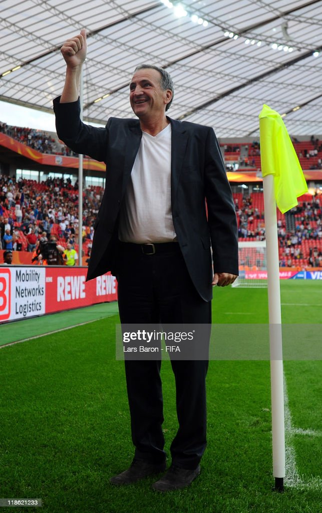 Head coach Bruno Bini of France celebrates after winning the FIFA Women's World Cup 2011 Quarter Final match between England and France at the FIFA Women's World Cup Stadium Leverkusen on July 9, 2011 in Leverkusen, Germany.