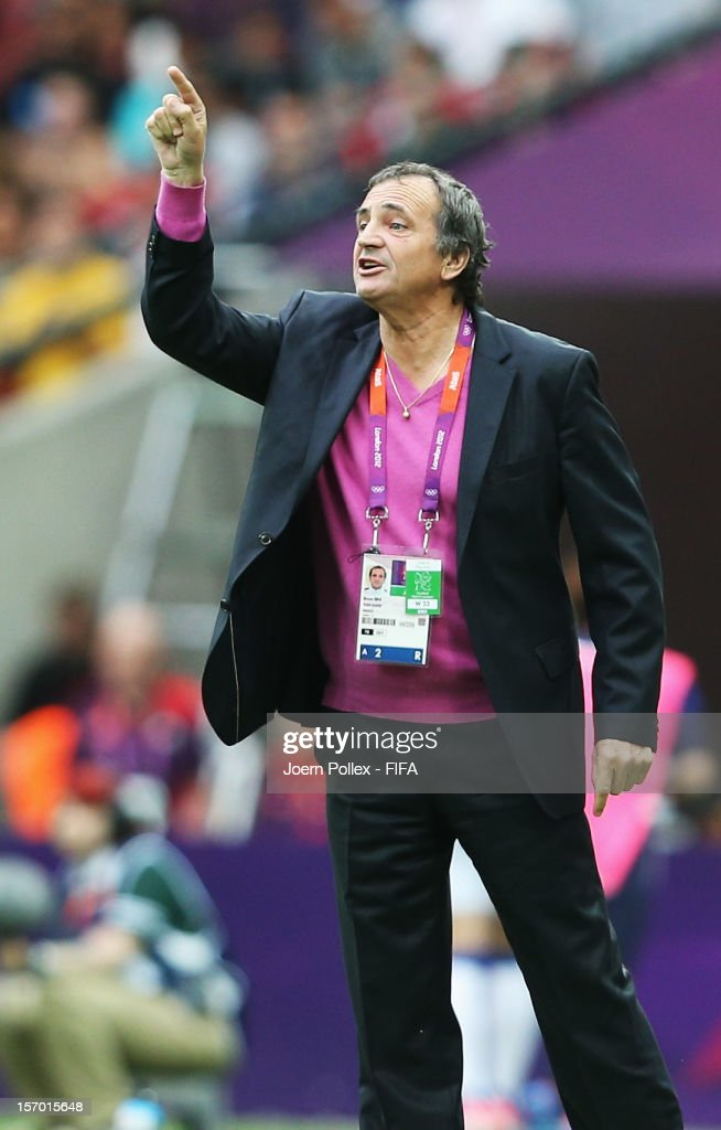 Head coach <a gi-track='captionPersonalityLinkClicked' href=/galleries/search?phrase=Bruno+Bini&family=editorial&specificpeople=2391630 ng-click='$event.stopPropagation()'>Bruno Bini</a> of France gestures during the Women's Football Semi Final match between France and Japan on Day 10 of the London 2012 Olympic Games at at Wembley Stadium on August 6, 2012 in London, England.