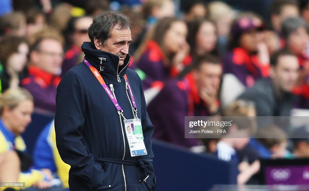 Head coach <a gi-track='captionPersonalityLinkClicked' href=/galleries/search?phrase=Bruno+Bini&family=editorial&specificpeople=2391630 ng-click='$event.stopPropagation()'>Bruno Bini</a> of France looks on during the Women's Football Quarter Final match between Sweden and France, on Day 7 of the London 2012 Olympic Games at Hampden Park on August 3, 2012 in Glasgow, Scotland.