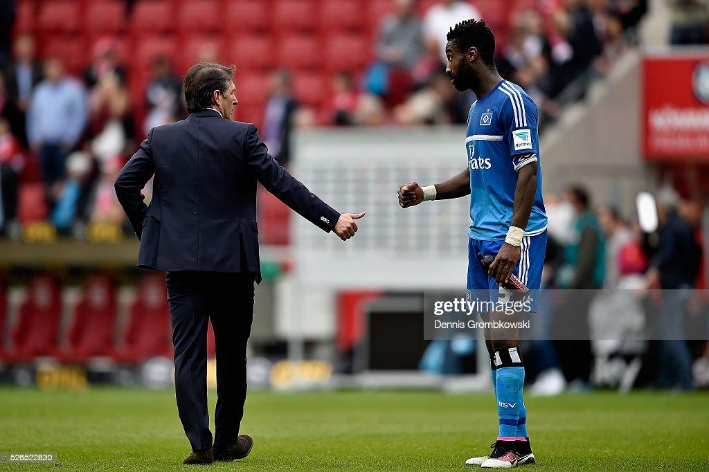 Head coach Bruno Labbadia of Hamburger SV reacts as he walks away from Johan Djourou after the Bundesliga match between 1. FSV Mainz 05 and Hamburger SV at Coface Arena on April 30, 2016 in Mainz, Germany.