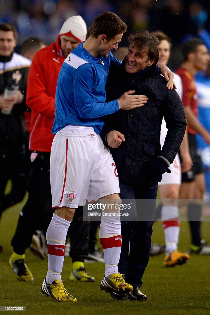Head coach <a gi-track='captionPersonalityLinkClicked' href=/galleries/search?phrase=Bruno+Labbadia&family=editorial&specificpeople=653790 ng-click='$event.stopPropagation()'>Bruno Labbadia</a> of Stuttgart and <a gi-track='captionPersonalityLinkClicked' href=/galleries/search?phrase=Christian+Gentner&family=editorial&specificpeople=228707 ng-click='$event.stopPropagation()'>Christian Gentner</a> celebrate after the UEFA Europa League Round of 32 second leg match between KRC Genk and VfB Suttgart at Cristal Arena on February 21, 2013 in Genk, Belgium.