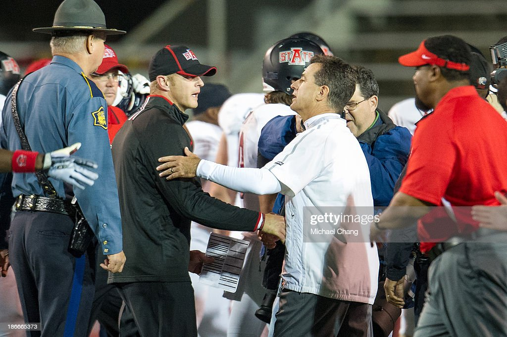 Head coach Bryan Harsin (L) of the Arkansas State Red Wolves shakes hands with head coach Joey Jones of the South Alabama Jaguars at the conclusion of their game on November 2, 2013 at Ladd-Peebles Stadium in Mobile, Alabama. Arkansas State defeated South Alabama 17-16.