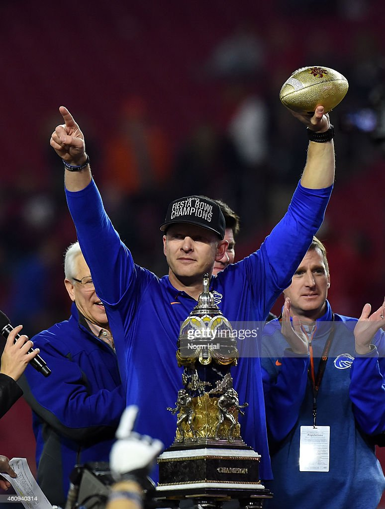 Head coach Bryan Harsin of the Boise State Broncos celebrates after beating the Arizona Wildcats 38-30 in the Vizio Fiesta Bowl at University of Phoenix Stadium on December 31, 2014 in Glendale, Arizona.