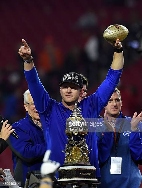 Head coach Bryan Harsin of the Boise State Broncos celebrates after beating the Arizona Wildcats 3830 in the Vizio Fiesta Bowl at University of...