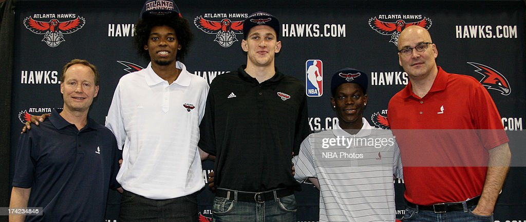 Head Coach Bud Budenholzer, Lucas Noguiera, Mike Muscala, Dennis Schroeder and General Manager Danny Ferry of the Atlanta Hawks poses for a portrait for a photo during an introductory press conference on June 29, 2013 at Philips Arena in Atlanta, Georgia.