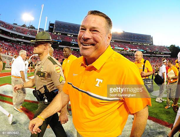 Head Coach Butch Jones of the Tennessee Volunteers celebrates after the game against the Georgia Bulldogs at Sanford Stadium on October 1 2016 in...