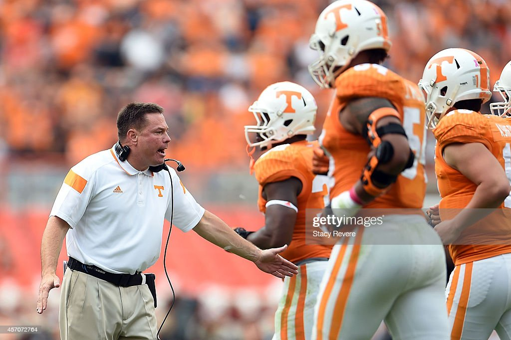 Head coach <a gi-track='captionPersonalityLinkClicked' href=/galleries/search?phrase=Butch+Jones&family=editorial&specificpeople=4501034 ng-click='$event.stopPropagation()'>Butch Jones</a> of the Tennessee Volunteers congratulates his players following a score against the Chattanooga Mocs during the second quarter of a game at Neyland Stadium on October 11, 2014 in Knoxville, Tennessee.