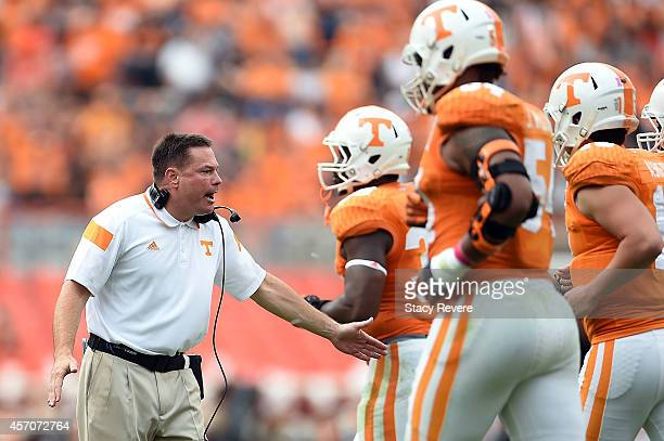 Head coach Butch Jones of the Tennessee Volunteers congratulates his players following a score against the Chattanooga Mocs during the second quarter...