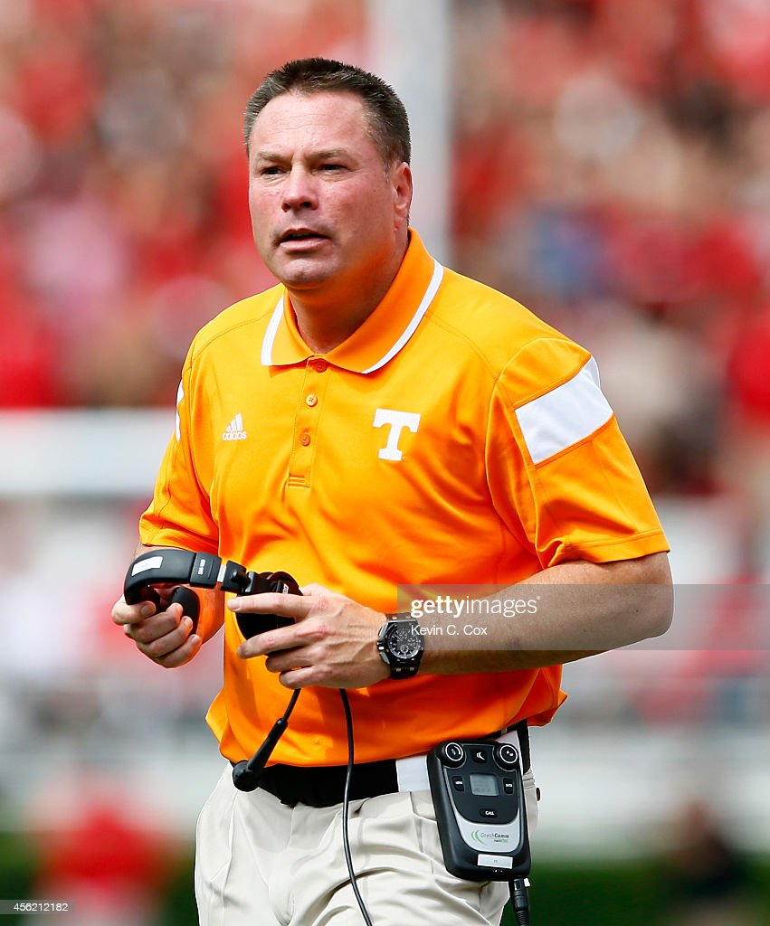 Head coach <a gi-track='captionPersonalityLinkClicked' href=/galleries/search?phrase=Butch+Jones&family=editorial&specificpeople=4501034 ng-click='$event.stopPropagation()'>Butch Jones</a> of the Tennessee Volunteers looks on during the game against the Georgia Bulldogs at Sanford Stadium on September 27, 2014 in Athens, Georgia.