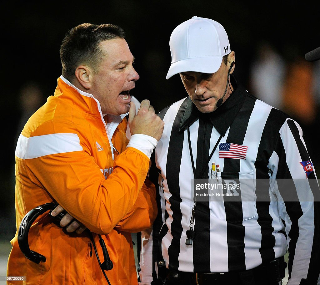 Head coach <a gi-track='captionPersonalityLinkClicked' href=/galleries/search?phrase=Butch+Jones&family=editorial&specificpeople=4501034 ng-click='$event.stopPropagation()'>Butch Jones</a> of the Tennessee Volunteers speaks to an official during the second half of a game against the Vanderbilt Commodores at Vanderbilt Stadium on November 29, 2014 in Nashville, Tennessee.