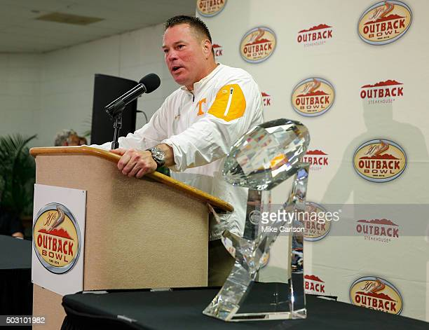 Head Coach Butch Jones of the Tennessee Volunteers speaks to the media after receiving the trophy for defeating Northwestern Wildcats in the Outback...