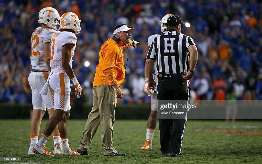 Head coach <a gi-track='captionPersonalityLinkClicked' href=/galleries/search?phrase=Butch+Jones&family=editorial&specificpeople=4501034 ng-click='$event.stopPropagation()'>Butch Jones</a> of the Tennessee Volunteers talks with an official during a game against the Florida Gators at Ben Hill Griffin Stadium on September 26, 2015 in Gainesville, Florida.