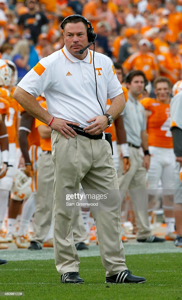 Head coach <a gi-track='captionPersonalityLinkClicked' href=/galleries/search?phrase=Butch+Jones&family=editorial&specificpeople=4501034 ng-click='$event.stopPropagation()'>Butch Jones</a> of the Tennessee Volunteers watches the action during the TaxSlayer Bowl against the Iowa Hawkeyes at EverBank Field on January 2, 2015 in Jacksonville, Florida.