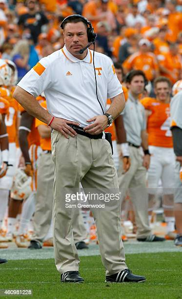 Head coach Butch Jones of the Tennessee Volunteers watches the action during the TaxSlayer Bowl against the Iowa Hawkeyes at EverBank Field on...