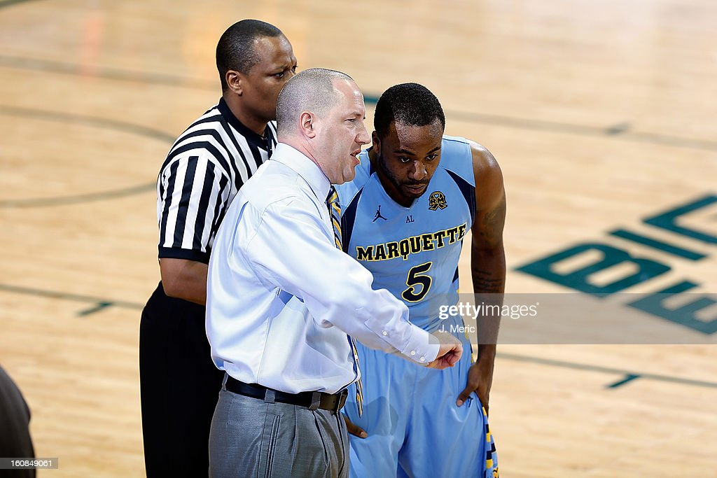 Head coach Buzz Williams of the Marquette Golden Eagles talks with Junior Cadougan #5 during the game against the South Florida Bulls at the Sun Dome on February 6, 2013 in Tampa, Florida.