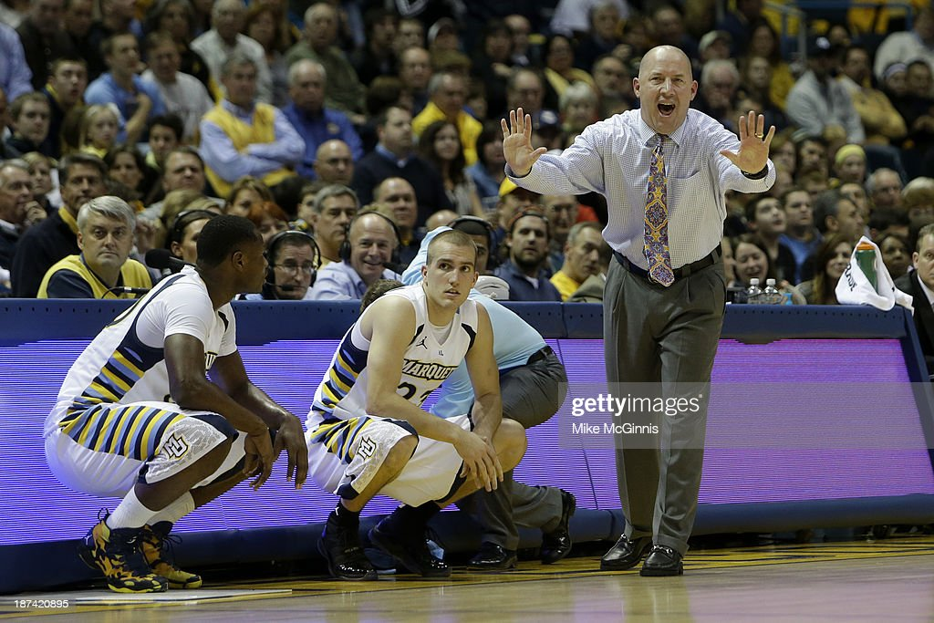 Head Coach Buzz Williams of the Marquette Golden Eagles yells from the sidelines during the first half of play against the Southern Jaguars against the Marquette Golden Eagles during the game at BMO Harris Bradley Center on November 08, 2013 in Madison, Wisconsin.