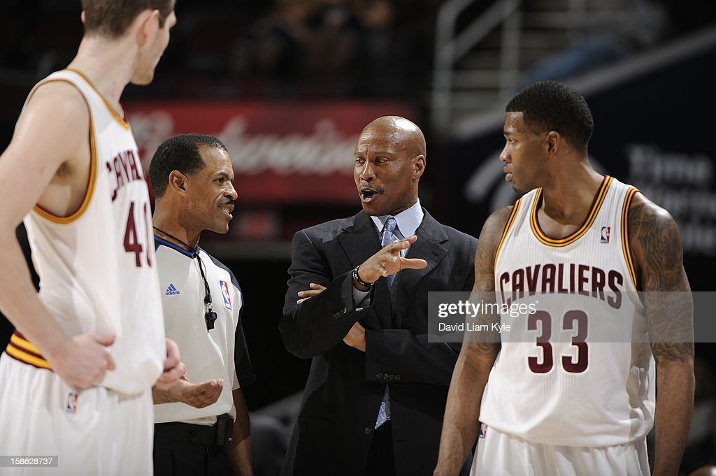 Head coach <a gi-track='captionPersonalityLinkClicked' href=/galleries/search?phrase=Byron+Scott+-+Basketball+Coach&family=editorial&specificpeople=209087 ng-click='$event.stopPropagation()'>Byron Scott</a> of the Cleveland Cavaliers discusses the previous play with player <a gi-track='captionPersonalityLinkClicked' href=/galleries/search?phrase=Alonzo+Gee&family=editorial&specificpeople=801443 ng-click='$event.stopPropagation()'>Alonzo Gee</a> #33 and official Eric Lewis during a break in the action against the Indiana Pacers at The Quicken Loans Arena on December 21, 2012 in Cleveland, Ohio.