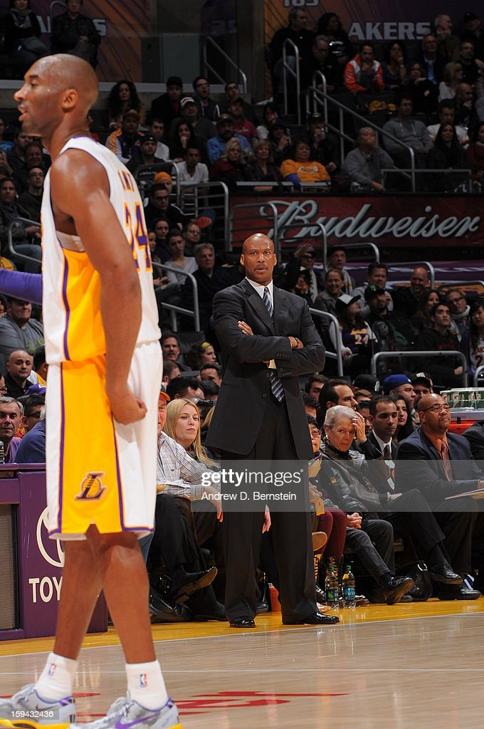 Head coach Byron Scott of the Cleveland Cavaliers looks on while Kobe Bryant #24 of the Los Angeles Lakers stands on the court during their game at Staples Center on January 13, 2013 in Los Angeles, California.