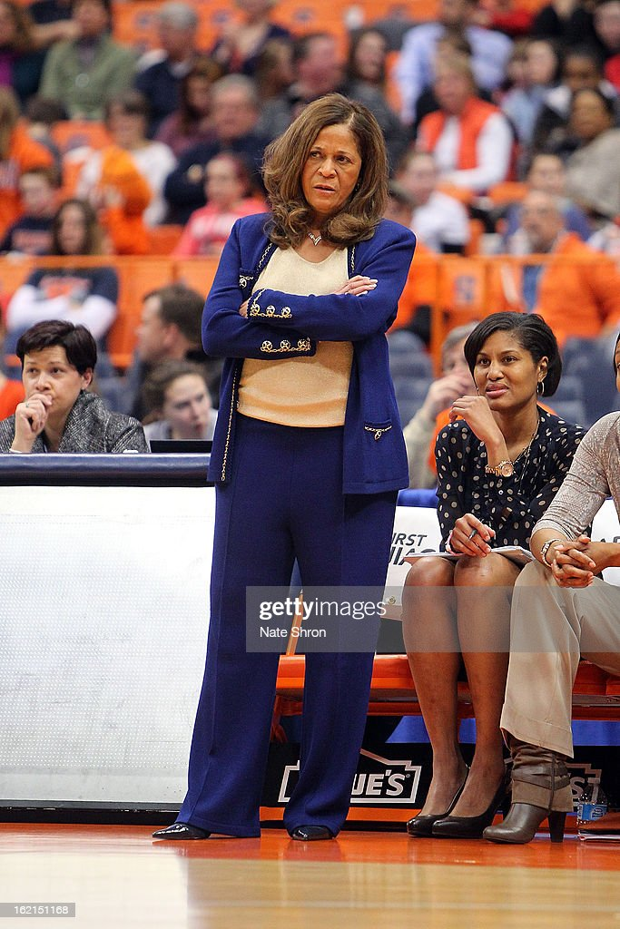 Head coach C. Vivian Stringer crosses her arms as she stands on the sideline in front of assistant coach Chelsea Newton of the Rutgers Scarlet Knights during the game against the Syracuse Orange at the Carrier Dome on February 19, 2013 in Syracuse, New York.