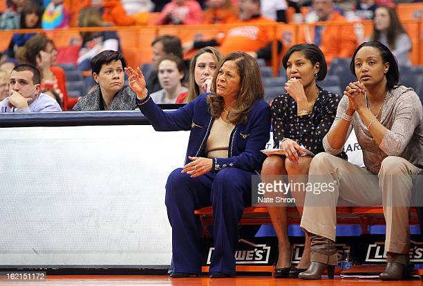 Head coach C Vivian Stringer gestures as she sits on the bench with assistant coach Chelsea Newton and assistant coach Tia Jackson of the Rutgers...